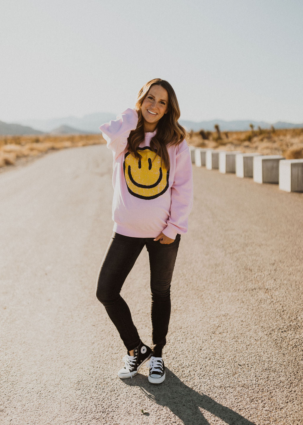 THE SMILEY FACE GRAPHIC PULLOVER IN LIGHT PINK
