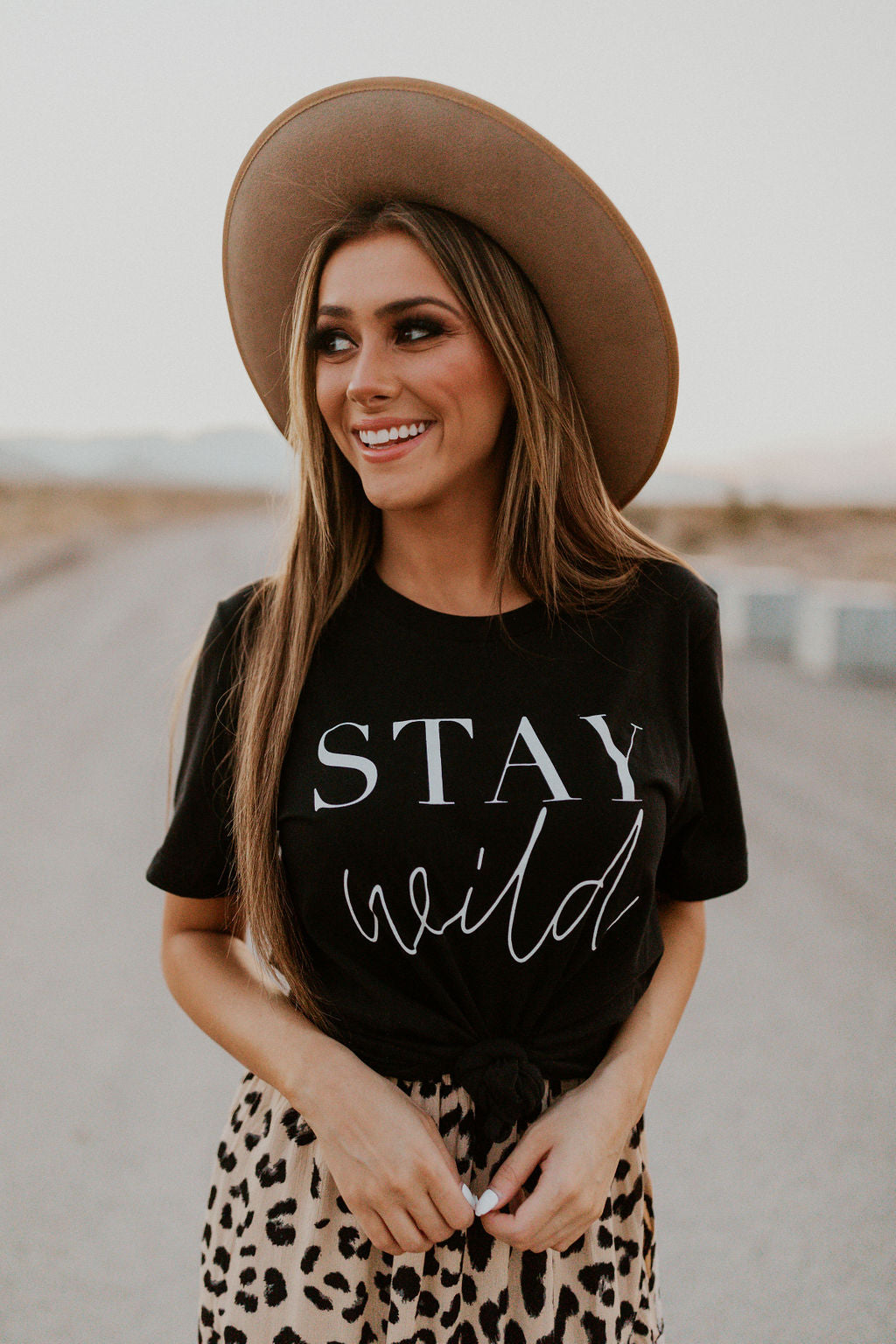 THE STAY WILD GRAPHIC TEE IN BLACK