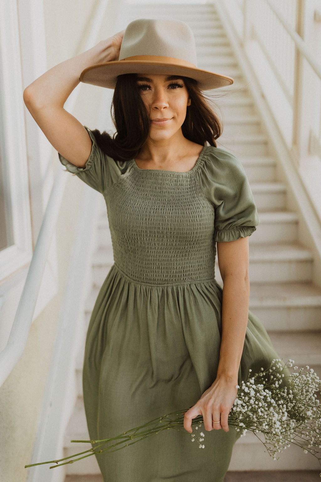 THE DYNASTY SMOCKED MIDI DRESS IN OLIVE GREEN