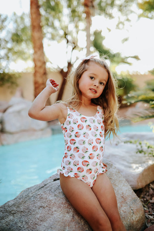 PINK DESERT GIRLS MINI RUFFLE LEG SCOOP ONE PIECE SWIMSUIT IN SUMMER STRAWBERRY