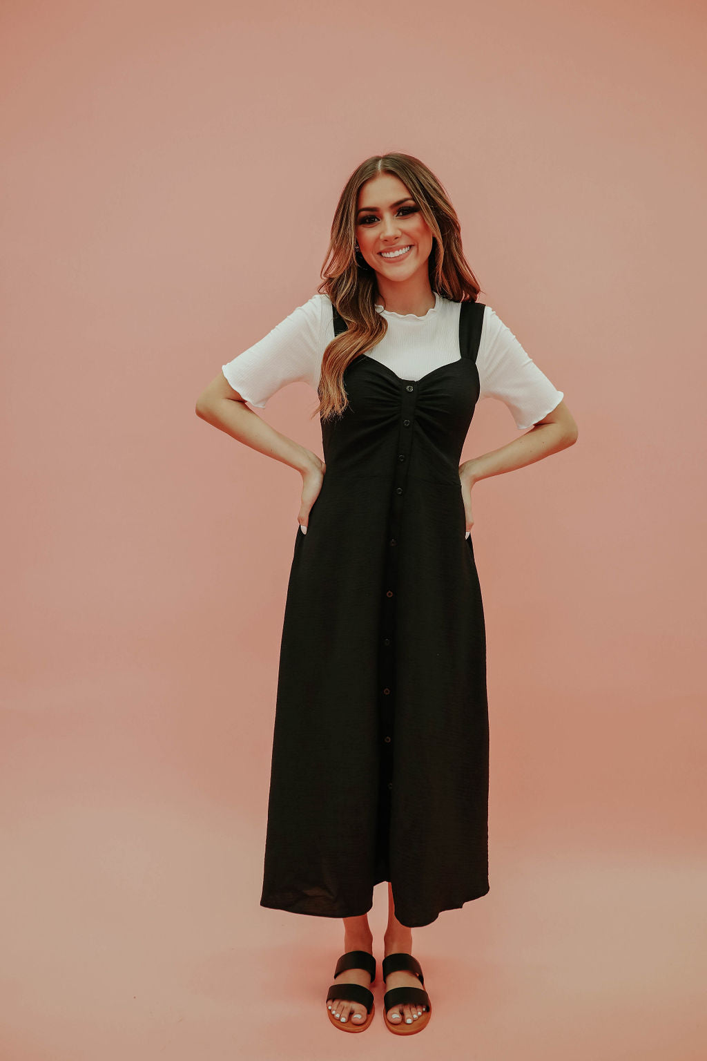 THE SUSANNA SLEEVELESS MIDI DRESS IN BLACK
