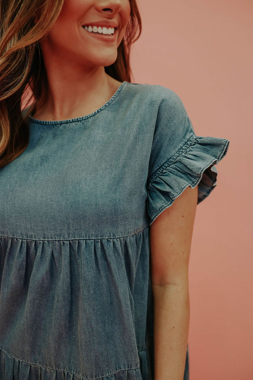 THE DEVYN DENIM RUFFLE MINI DRESS