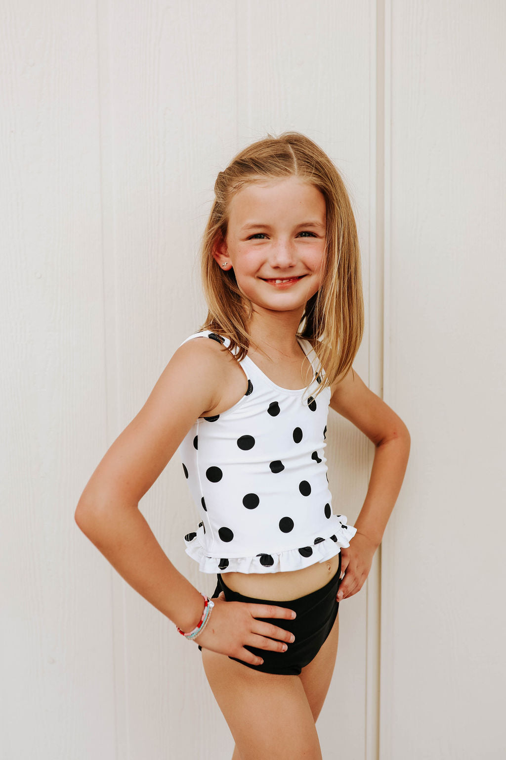 PINK DESERT GIRLS MINI RUFFLE PEPLUM SWIMSUIT SET IN POLKA DOT AND BLACK