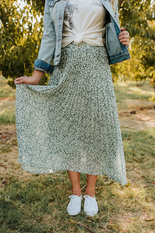 THE LILA LEOPARD PLEATED MIDI SKIRT IN DUSTY SAGE