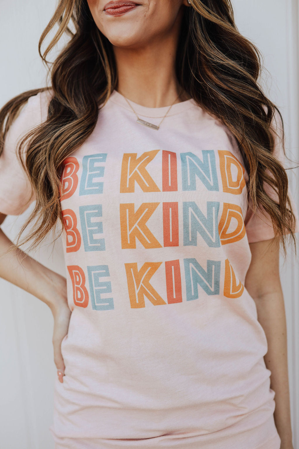 THE TRIPLE BE KIND GRAPHIC TEE IN PEACH