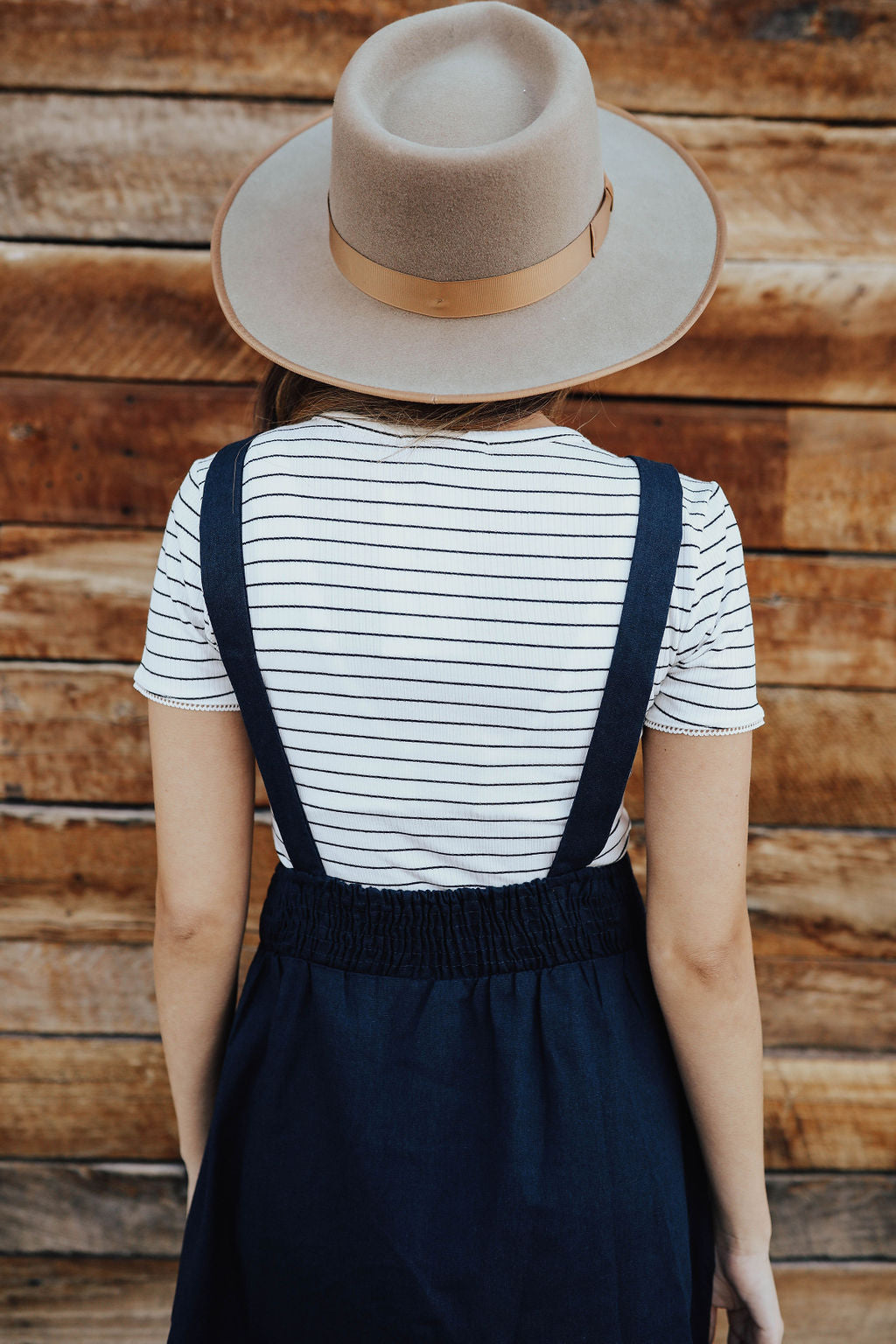 THE MARIANNE OVERALL DRESS IN DARK NAVY