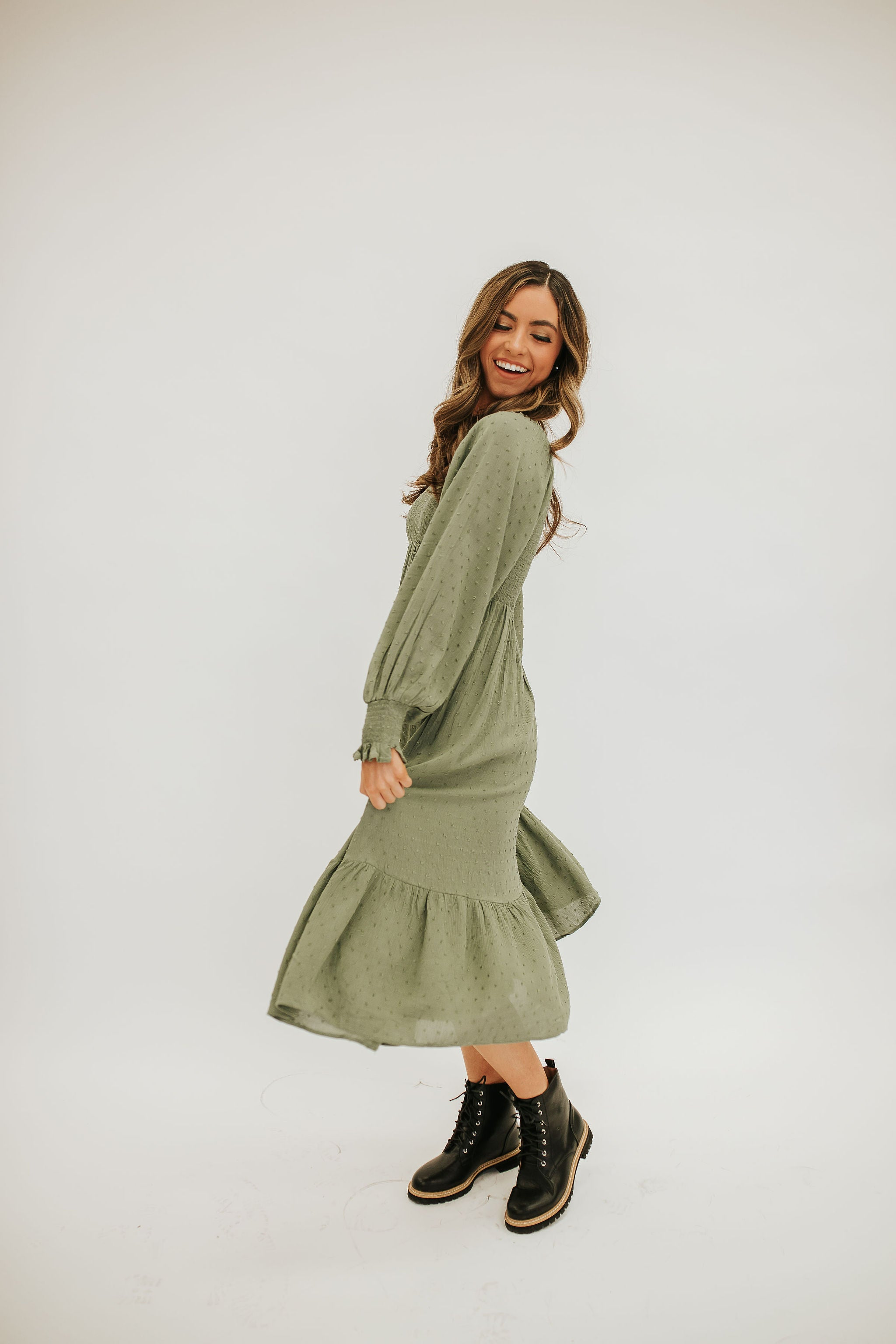 THE SCOUT SMOCKED SWISS DOT MIDI DRESS IN DUSTY OLIVE