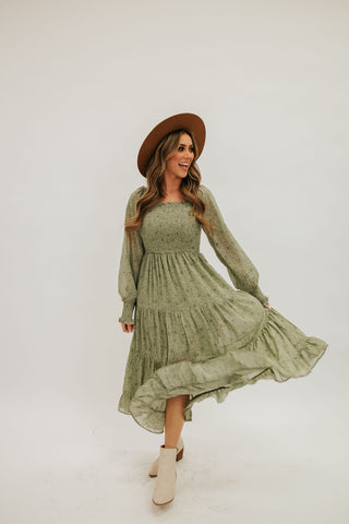 THE FARAH SMOCKED FLORAL DRESS IN SAGE