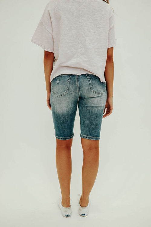 THE MID RISE DISTRESSED BERMUDA SHORT