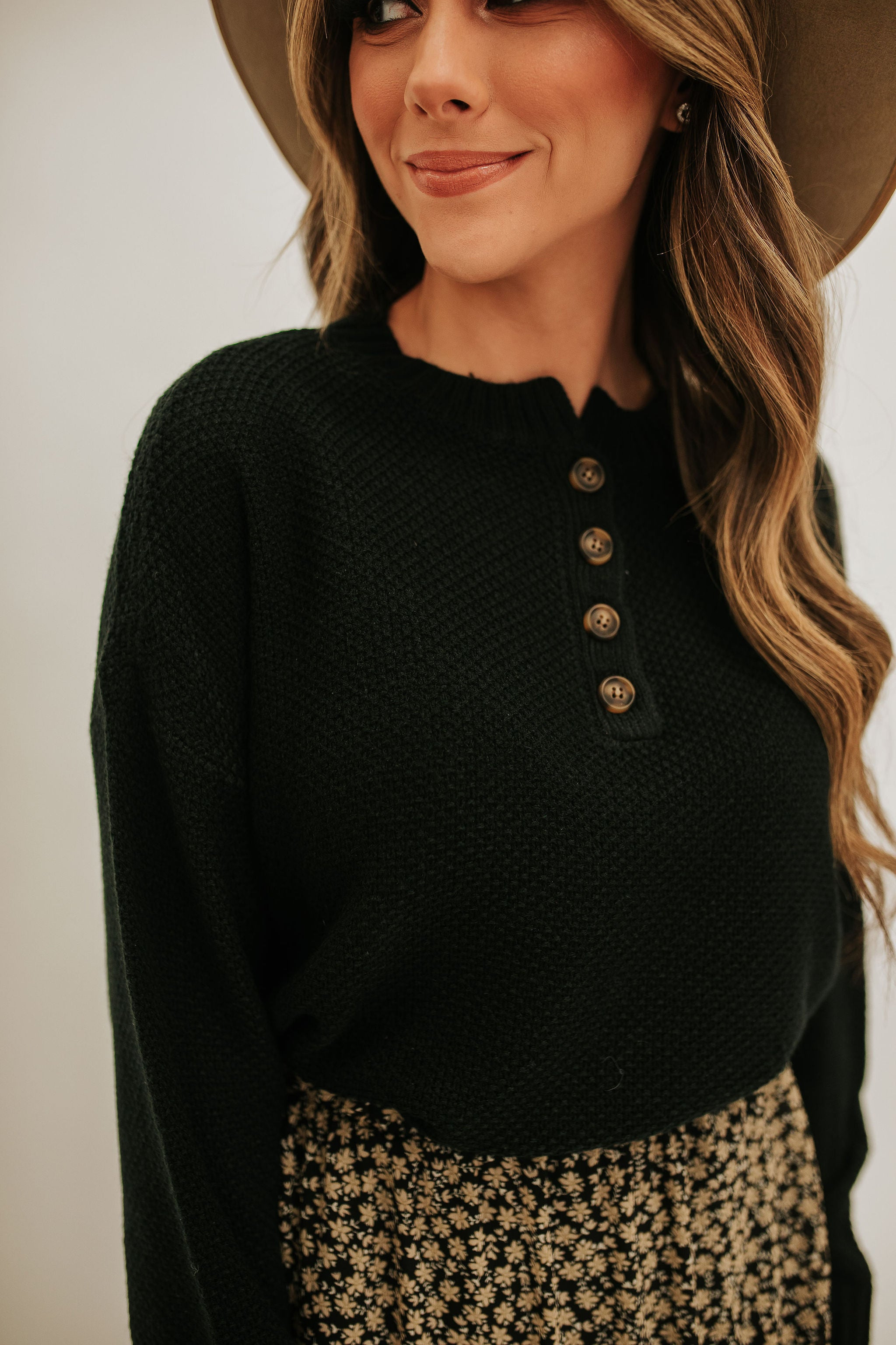 THE BRIDGETTE BUTTON FRONT SWEATER IN BLACK