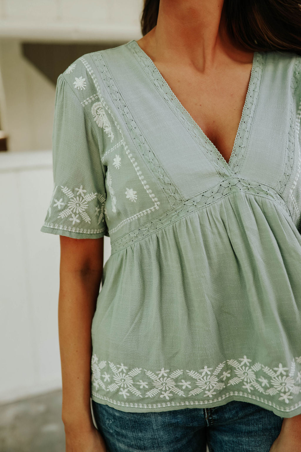 THE EARNEST EMBROIDERED BABYDOLL TOP IN DUSTY SAGE