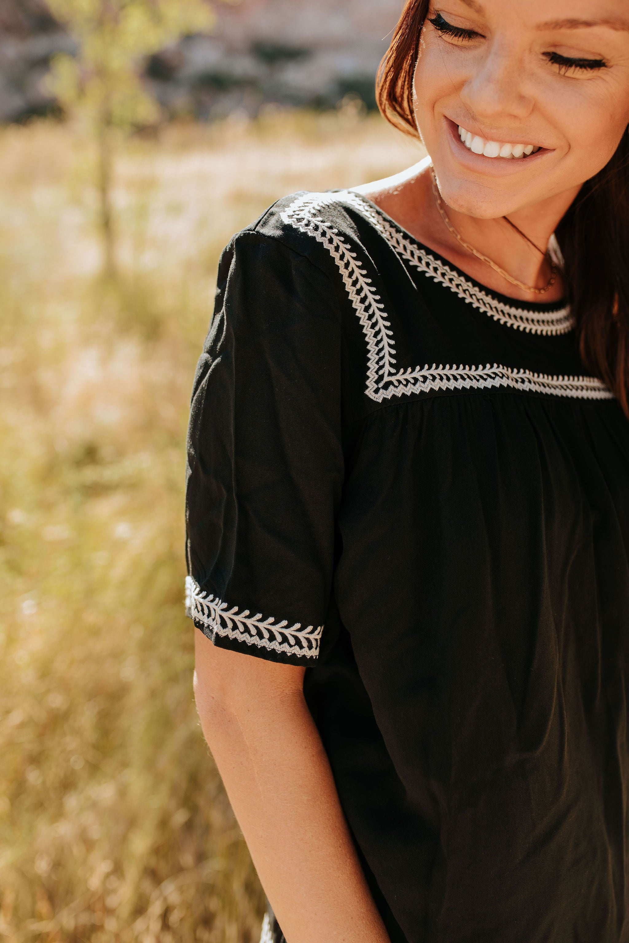 THE DAY TRIP EMBROIDERED TOP IN BLACK