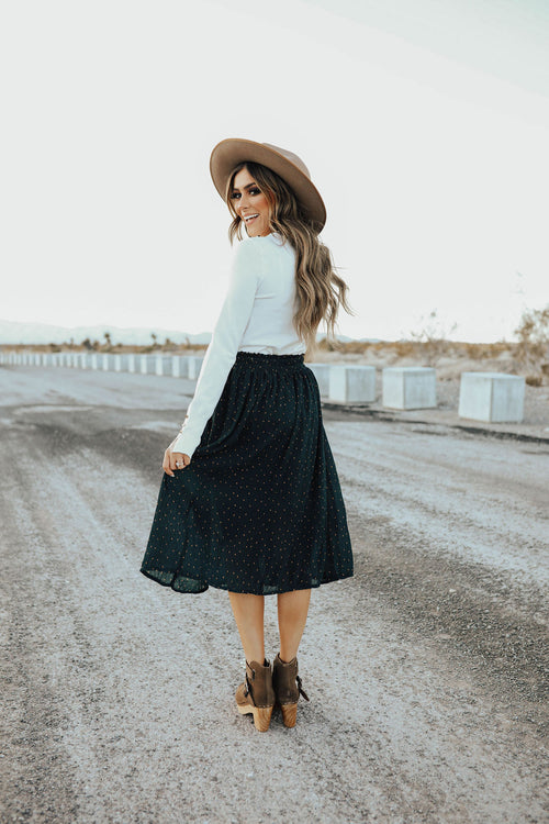 THE CORNELL CRINKLE DOTTED MIDI SKIRT IN DARK GREEN
