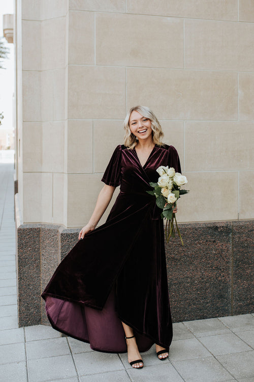 THE REGAL VELVET WRAP DRESS BY PINK DESERT IN PLUM