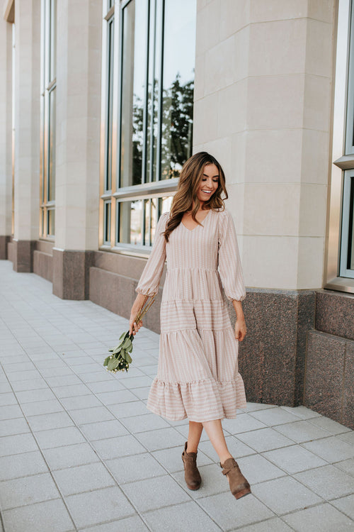 THE TYRA TIERED MIDI DRESS IN TAUPE