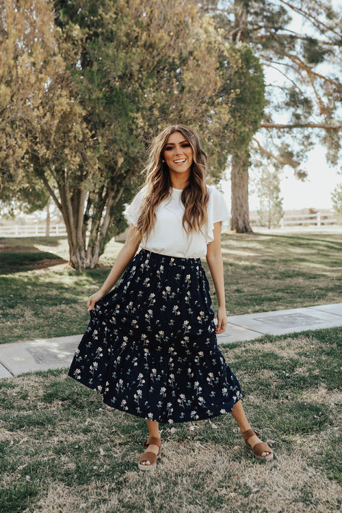THE KRISTA FLORAL MIDI SKIRT IN NAVY
