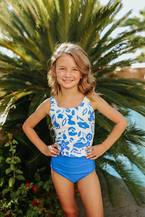 PINK DESERT GIRLS MINI RUFFLE PEPLUM SWIMSUIT SET IN BLUE FLORAL AND ROYAL BLUE