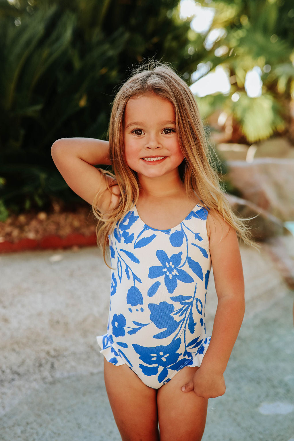 PINK DESERT GIRLS MINI RUFFLE LEG SCOOP ONE PIECE SWIMSUIT IN BLUE FLORAL