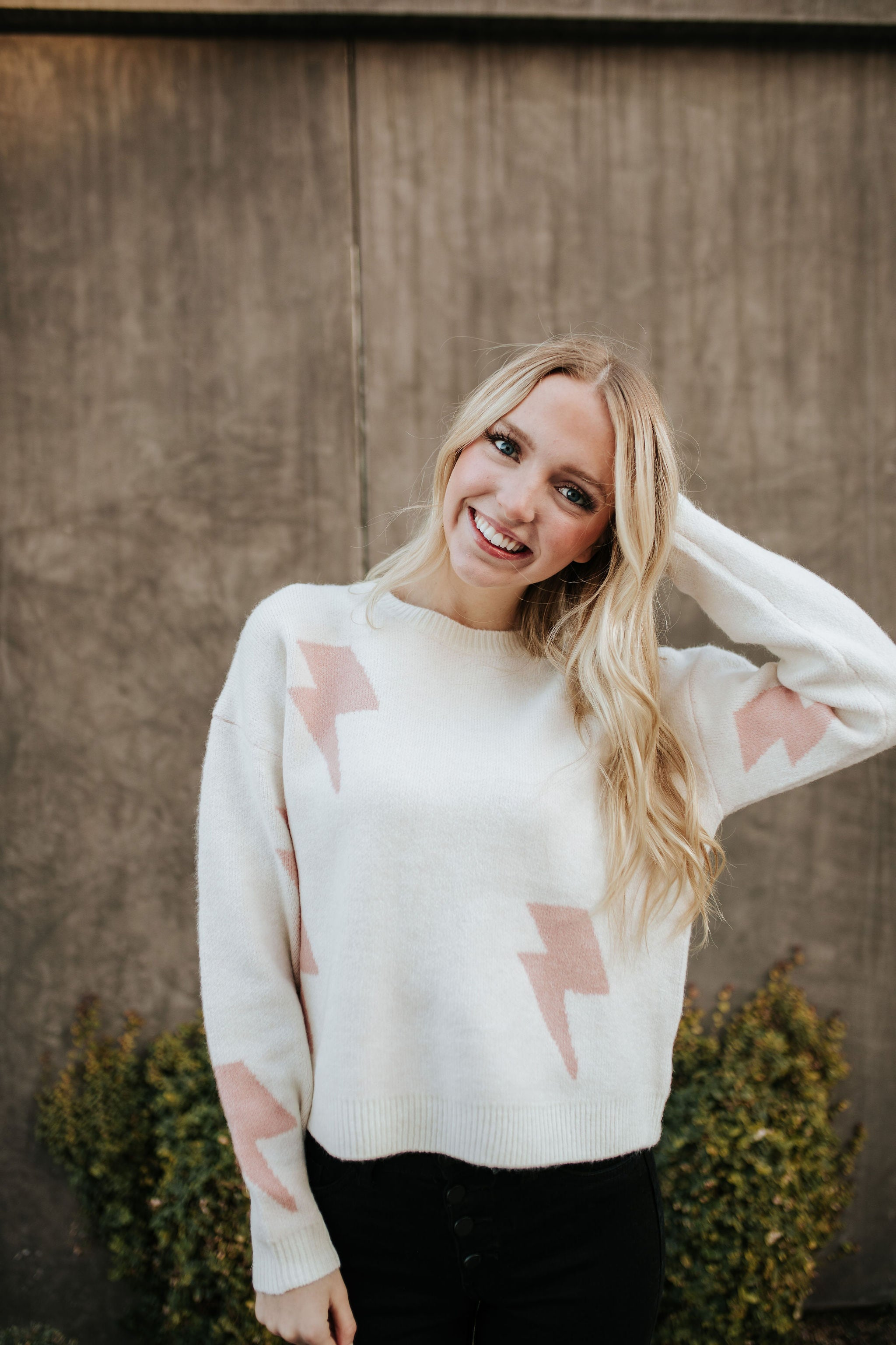 THE LEO LIGHTNING BOLT SWEATER IN IVORY AND PINK