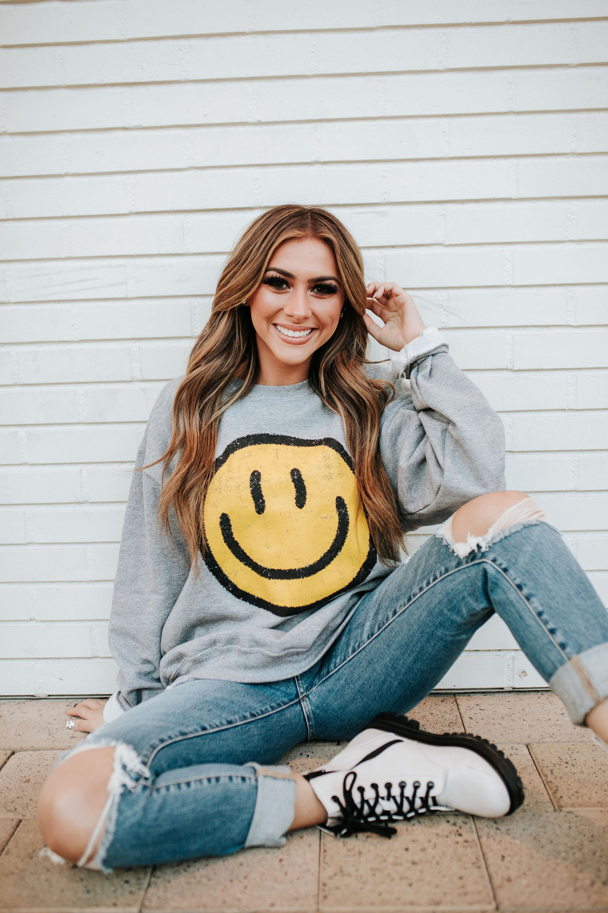 THE SMILEY FACE GRAPHIC PULLOVER IN HEATHERED GREY