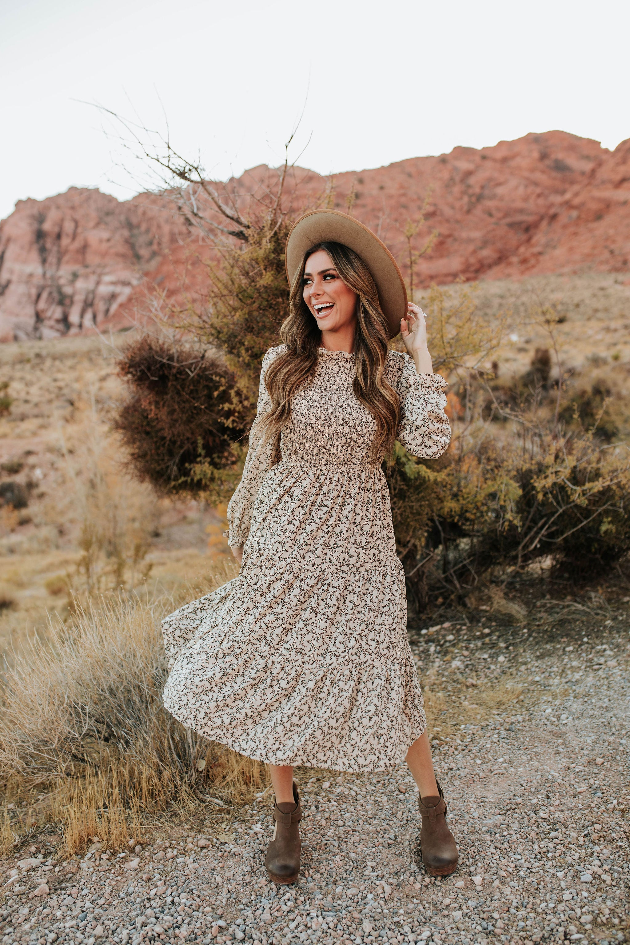THE BLANCA SMOCKED MIDI DRESS IN BEIGE FLORAL