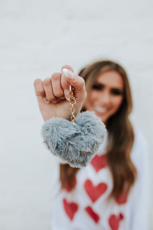 THE HEART POM POM KEY CHAIN IN GREY