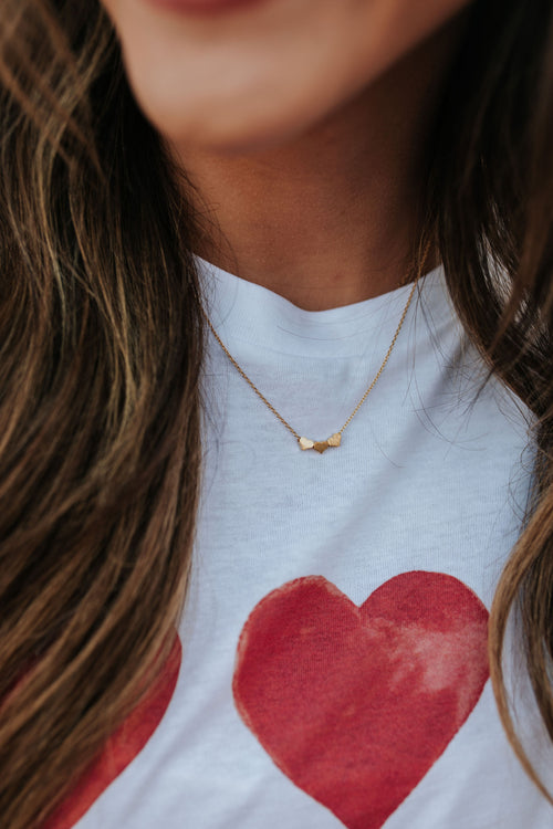 THE DAINTY TRIPLE HEART NECKLACE IN GOLD