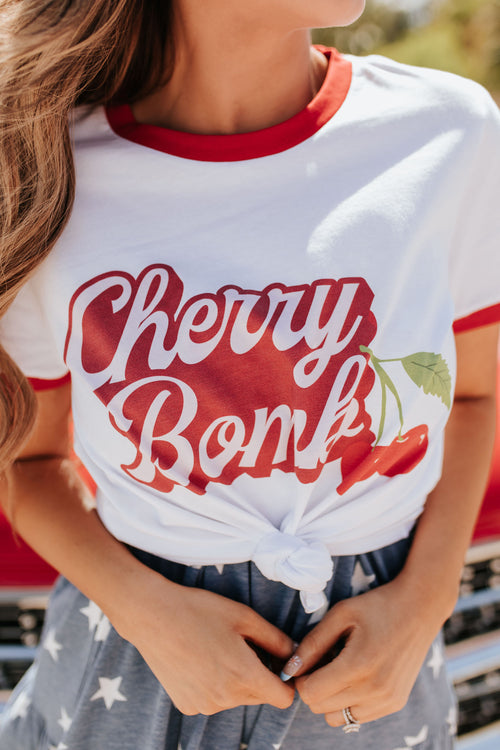 THE PINK DESERT CHERRY BOMB GRAPHIC TEE IN WHITE