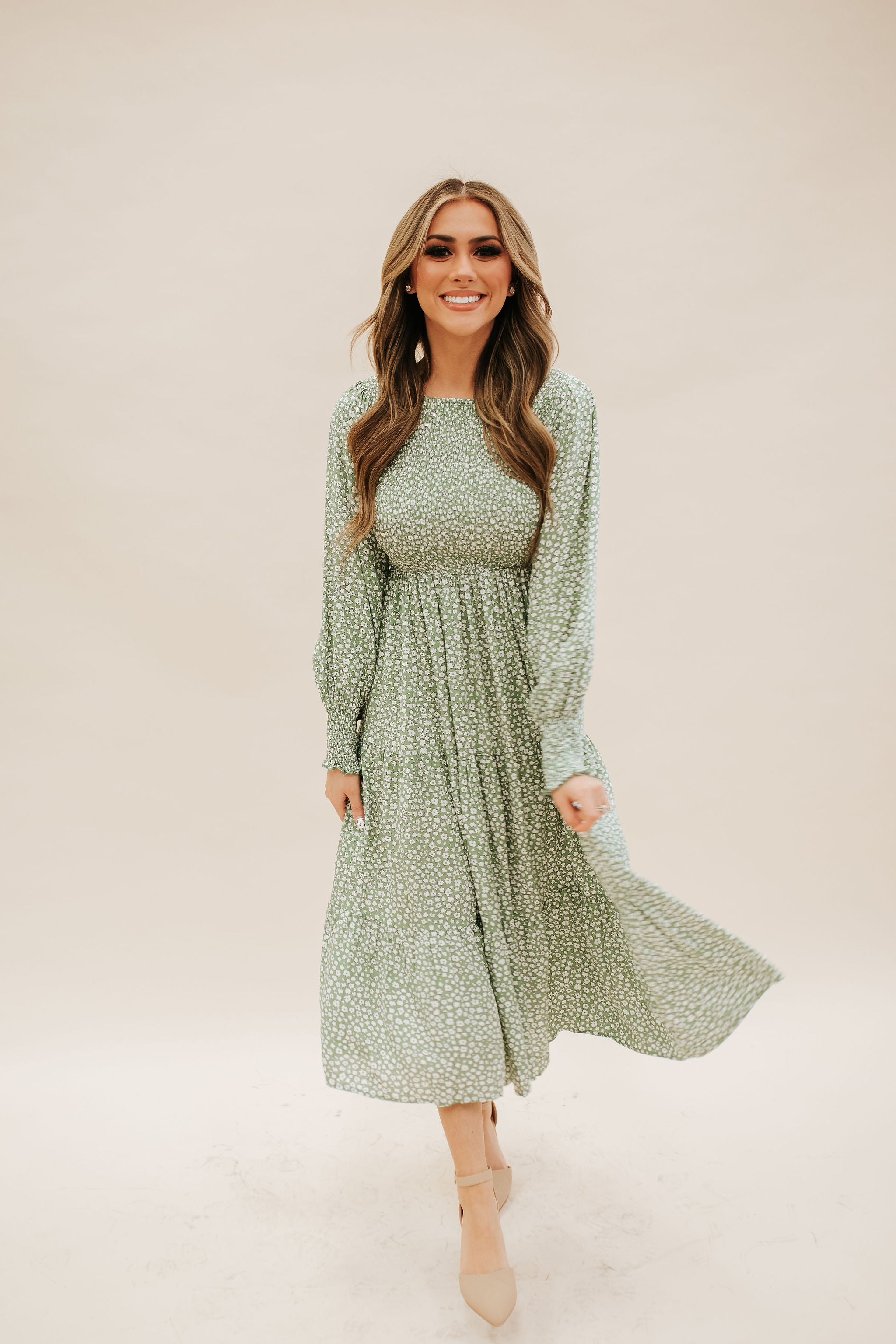 THE SEBASTIAN SMOCKED MIDI DRESS IN GREEN FLORAL