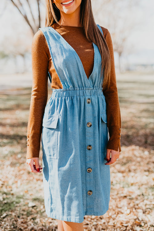 THE TRISTA OVERALL DRESS IN LIGHT DENIM