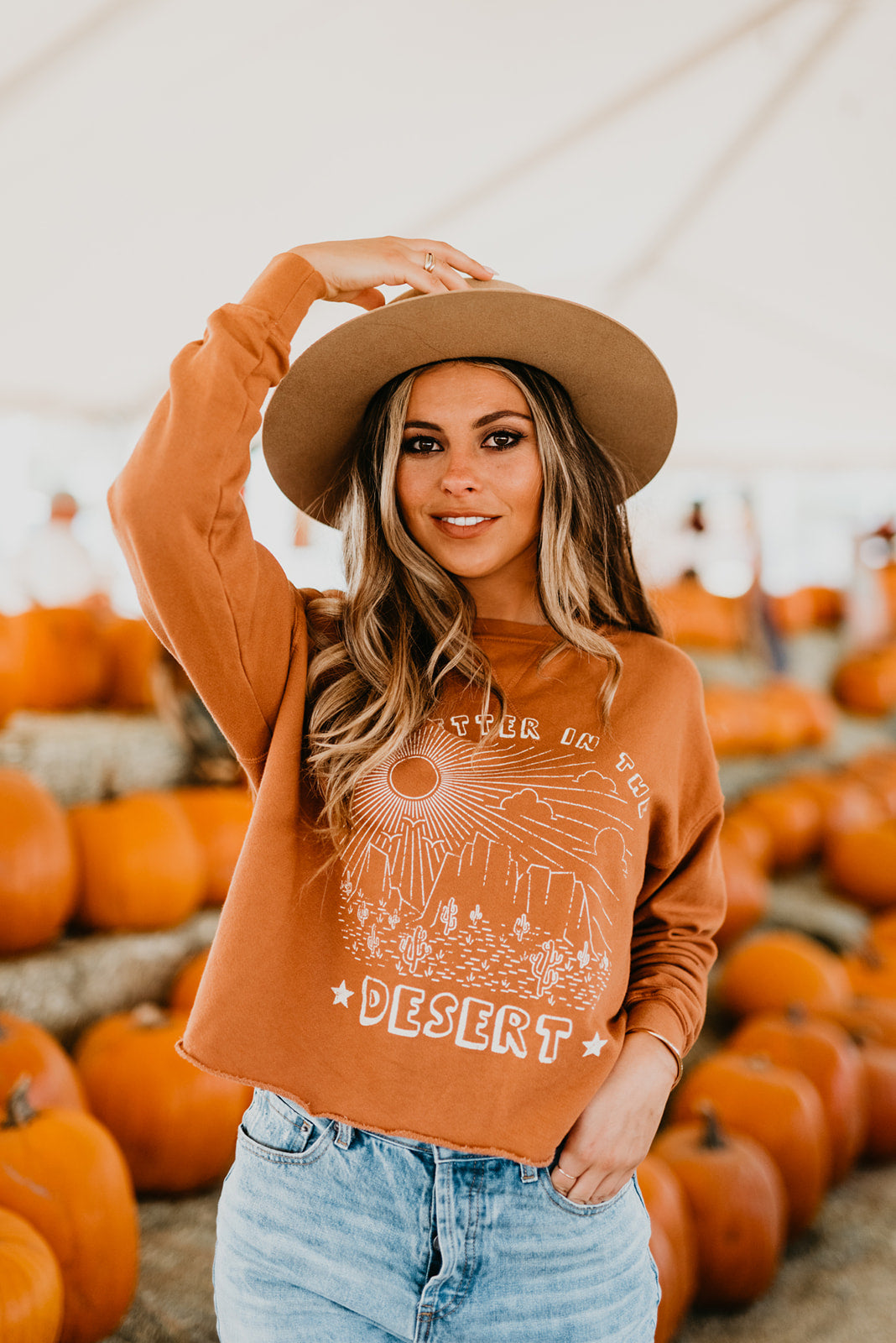 THE IT'S BETTER IN THE DESERT CROP SWEATER IN RUST