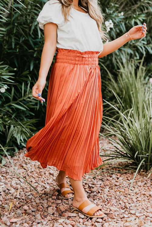 THE PEGGY PLEATED MIDI SKIRT IN PEACH