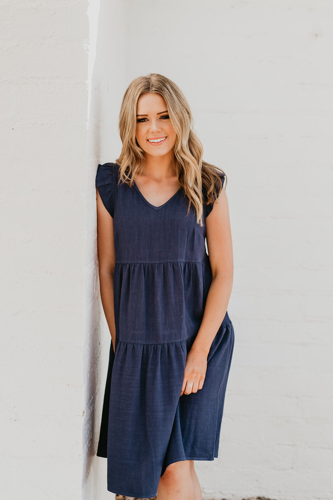 THE SCARLETT TIERED MIDI DRESS IN NAVY
