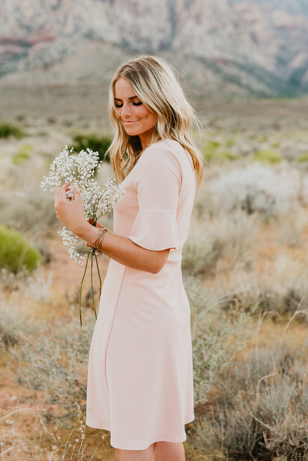 THE PENNY PEPLUM SLEEVE MIDI DRESS IN BLUSH
