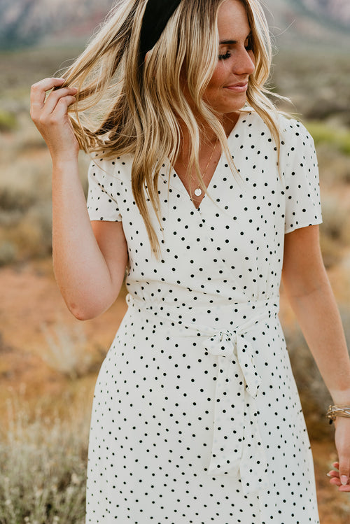 THE DOLLY DOT TIE FRONT DRESS IN CREAM