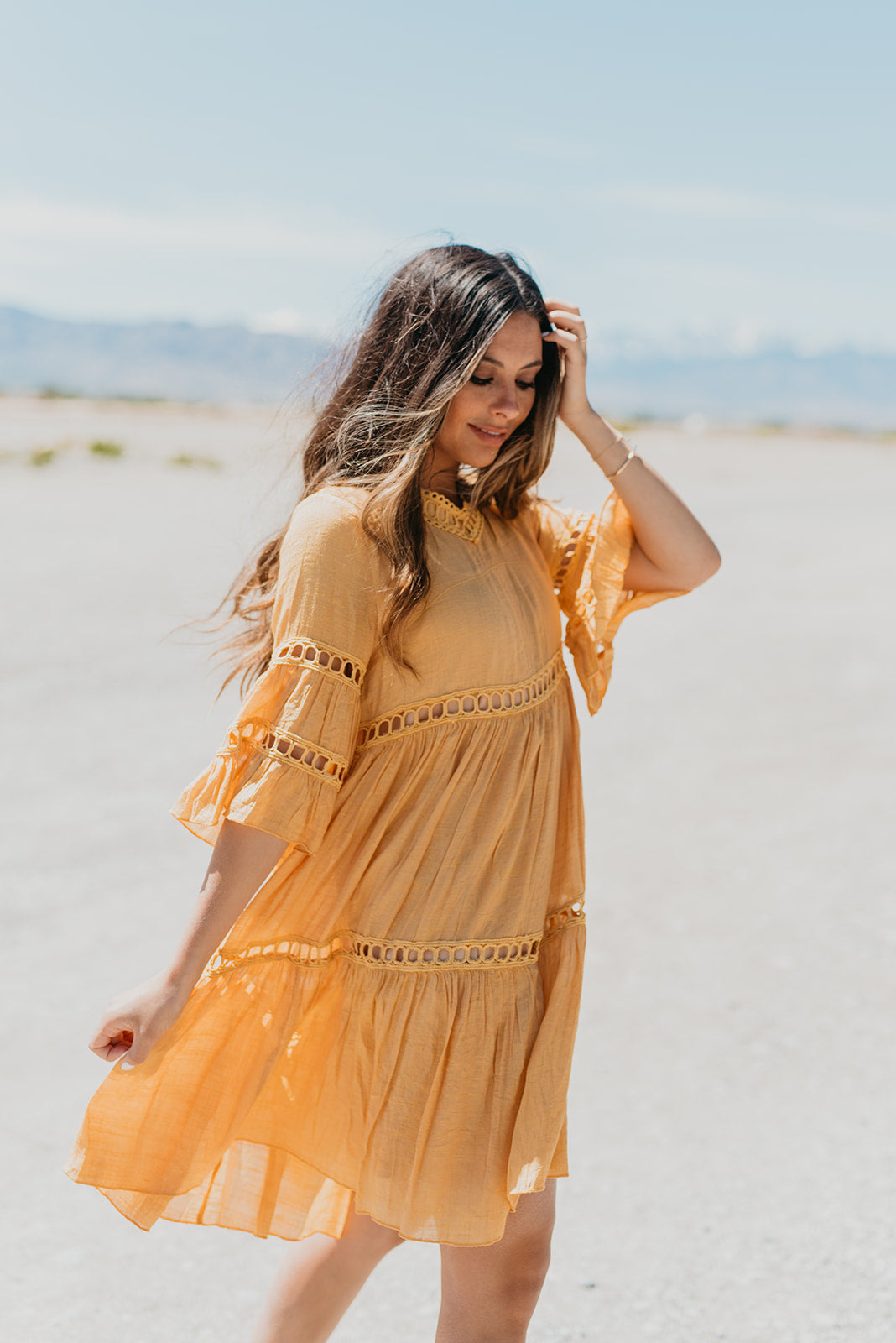 THE CABO LACE BABYDOLL DRESS IN MUSTARD