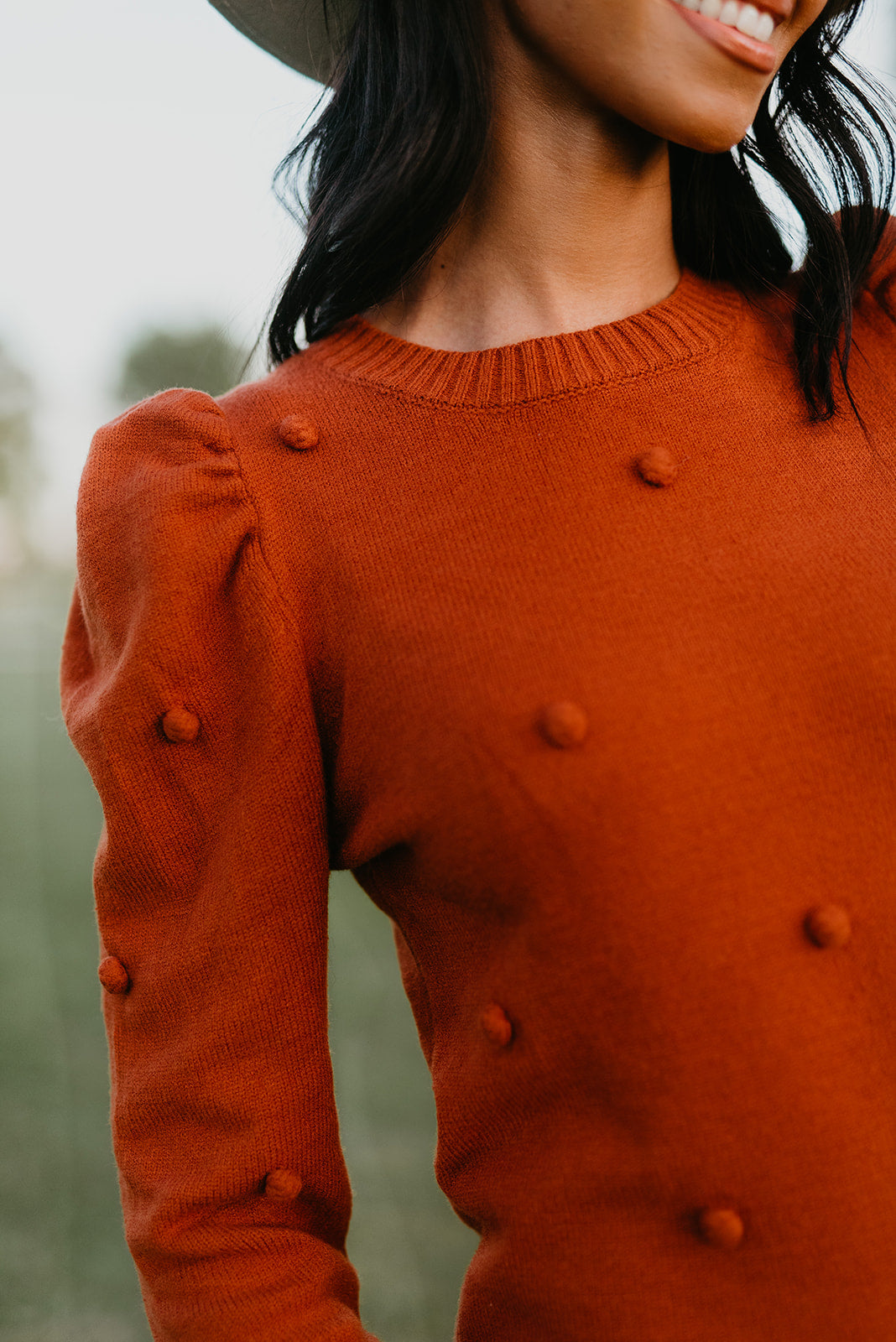 THE PERCY POM SWEATER IN RUST