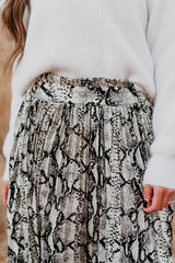 THE BELLA PLEATED SKIRT IN SNAKE SKIN