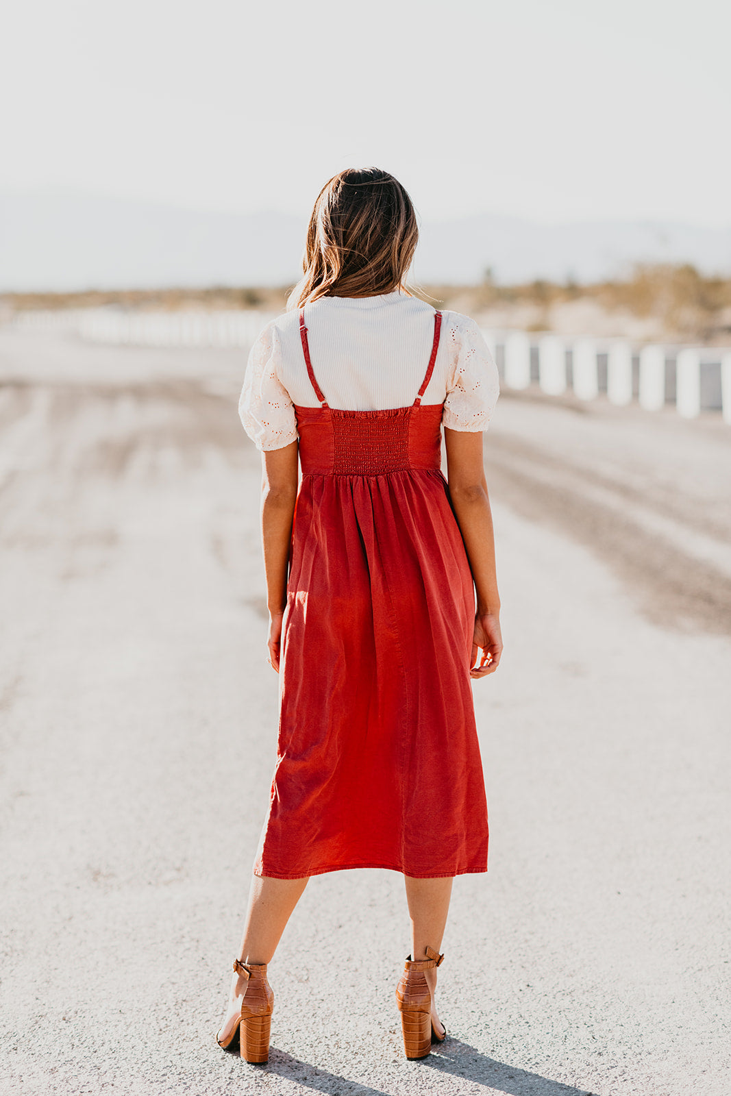 THE CHENEY SLEEVELESS DRESS IN RUST