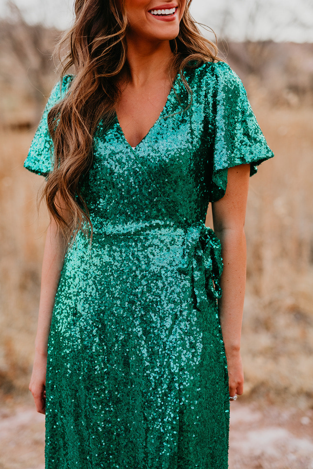 THE ANASTASIA WRAP DRESS IN SEQUINED EMERALD