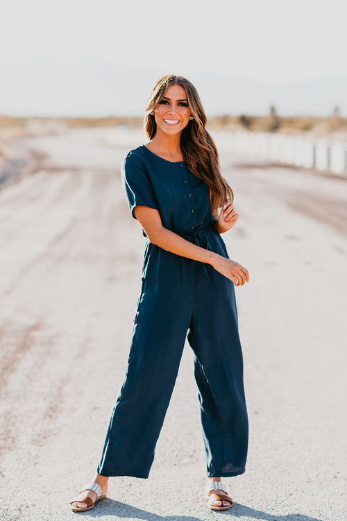 THE REAGYN BUTTON DOWN JUMPSUIT IN NAVY