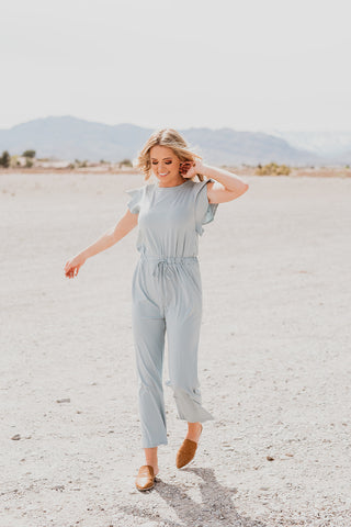 THE QUINN STRIPE LONG SLEEVE JUMPSUIT IN BLACK