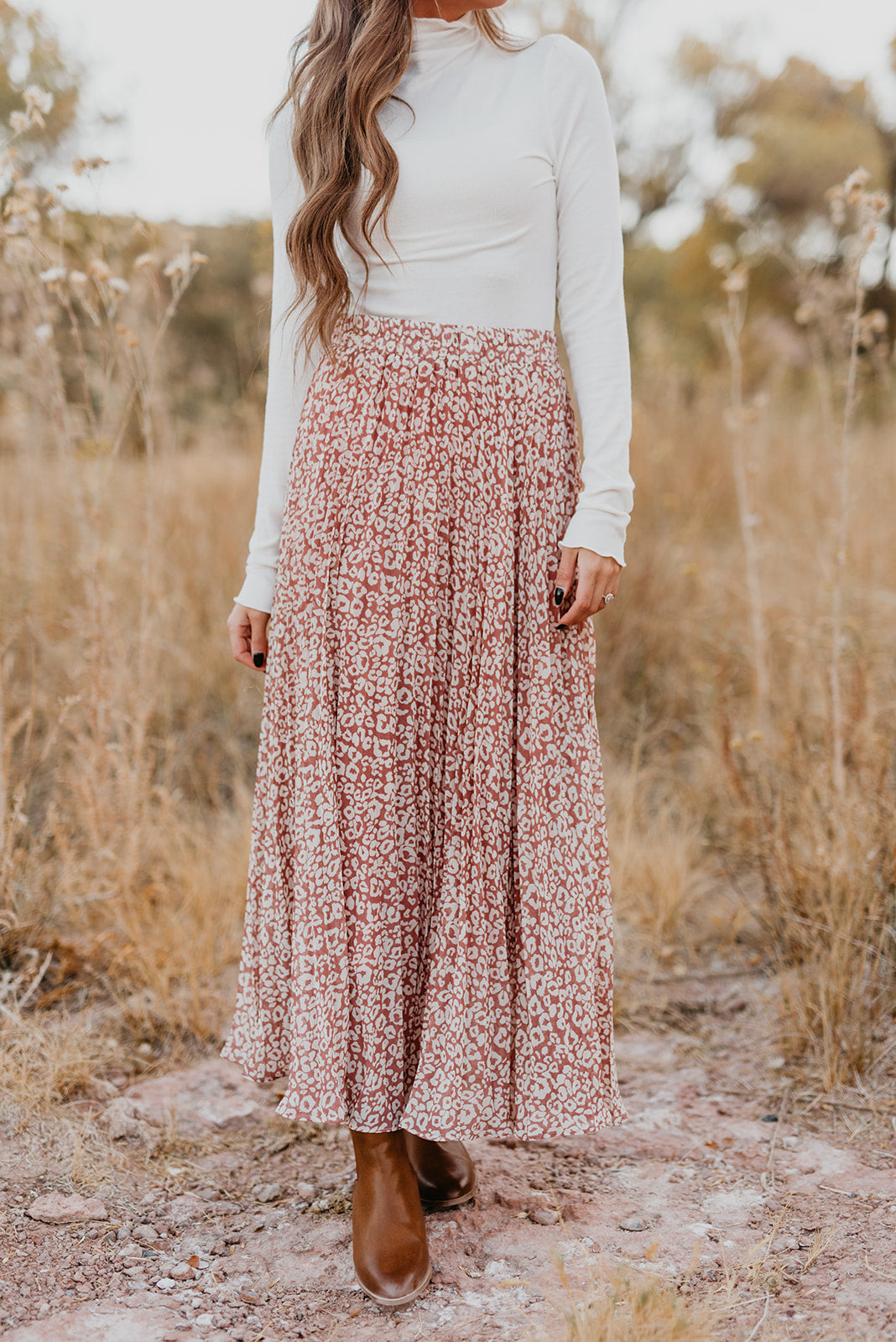 THE LILA LEOPARD PLEATED MIDI SKIRT IN DUSTY PINK