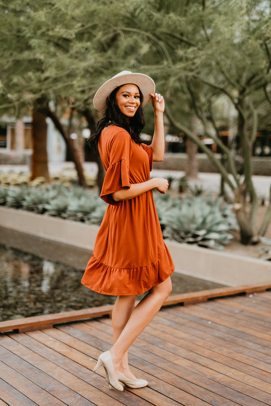 THE FALLON FAUX WRAP MIDI DRESS IN RUST