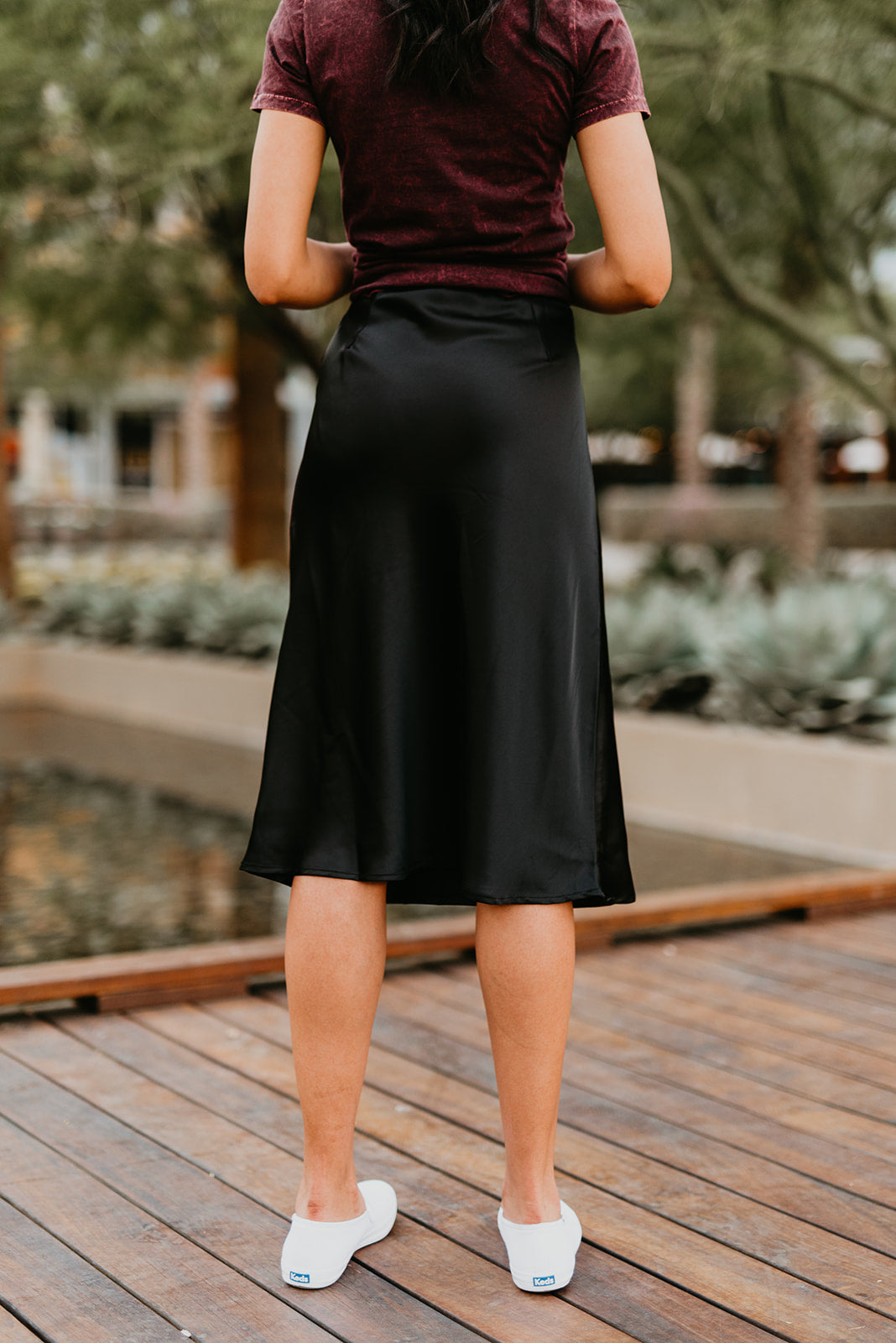 THE SABRINA SATIN MIDI SKIRT IN BLACK