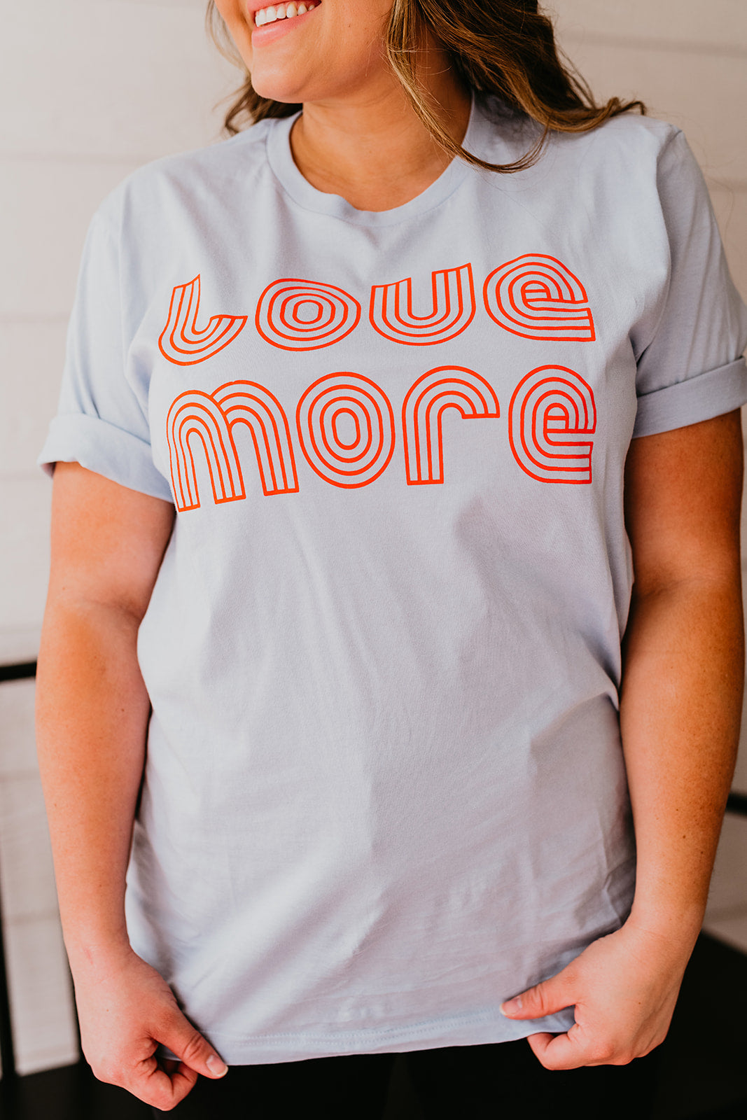 THE LOVE MORE GRAPHIC TEE IN LIGHT BLUE