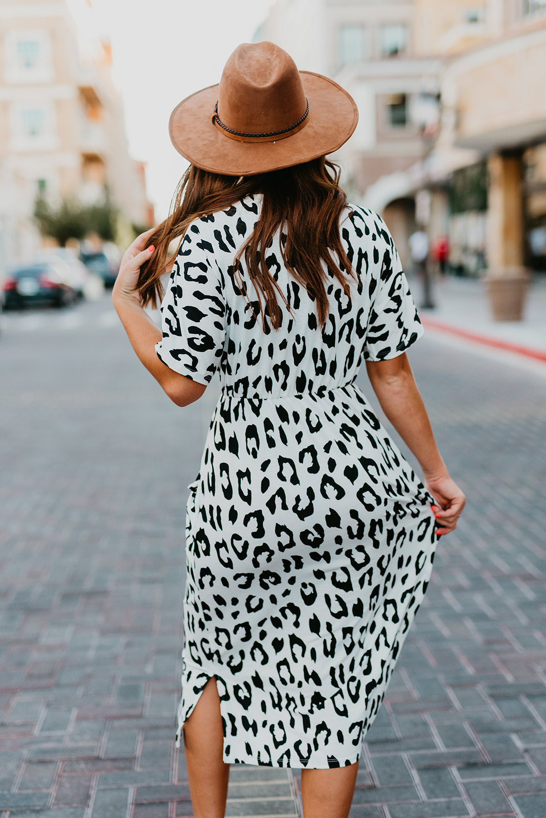 THE DESIRAE DRAPE POCKET KNIT DRESS IN OFF WHITE LEOPARD