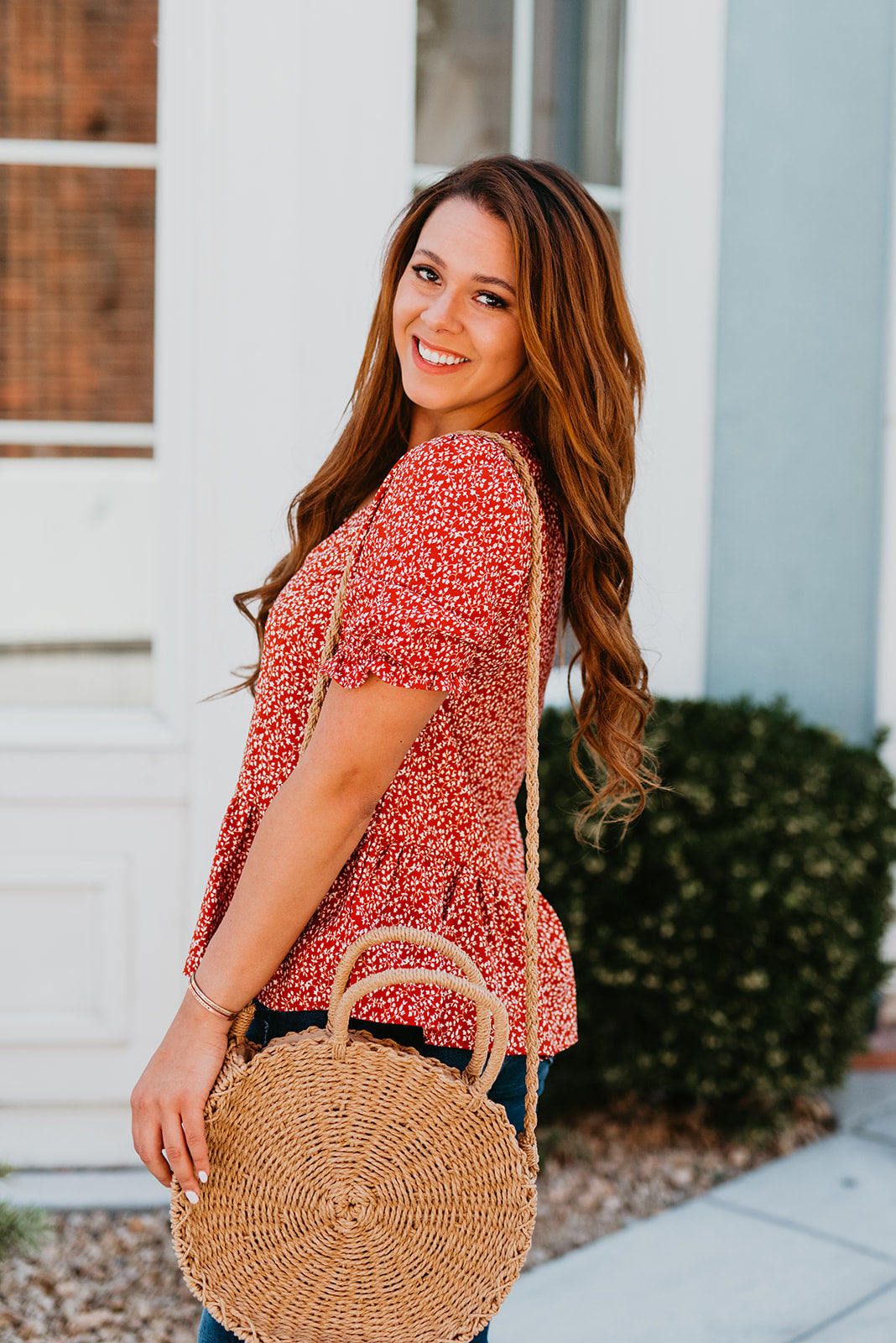 THE CHANNING PEPLUM FLORAL TOP IN RED
