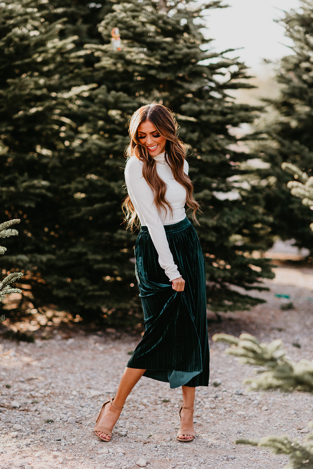 THE PETRA PLEATED VELVET SKIRT IN HUNTER GREEN