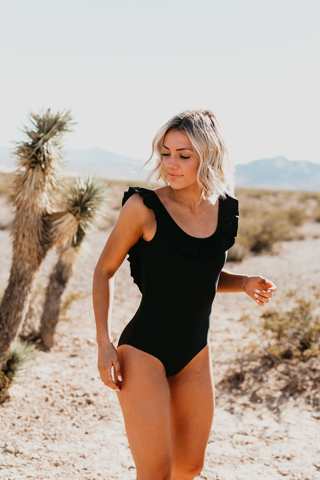 THE RUFFLE SCOOP ONE PIECE IN BLACK